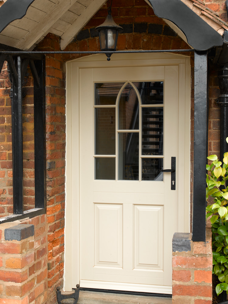 Cream front entrance door porch glass detail wrought iron furniture