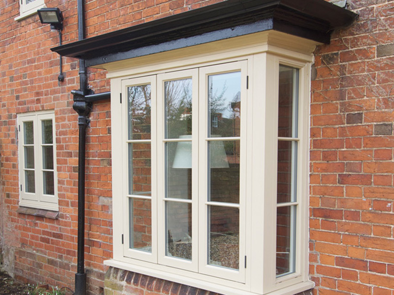 cottage flush casement window five pane bay