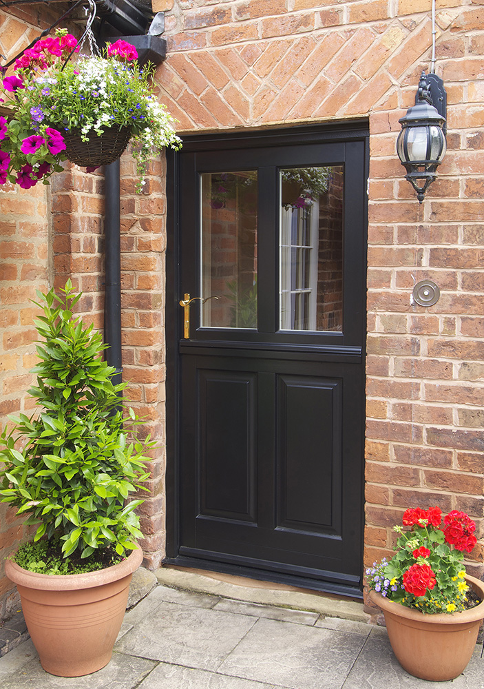 stable back entrance door black brass furniture glass panel